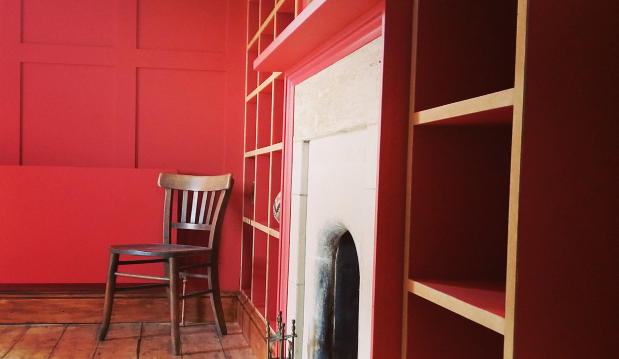 Red-Panelling-and-Bookshelves.charlie-caffyn-designs